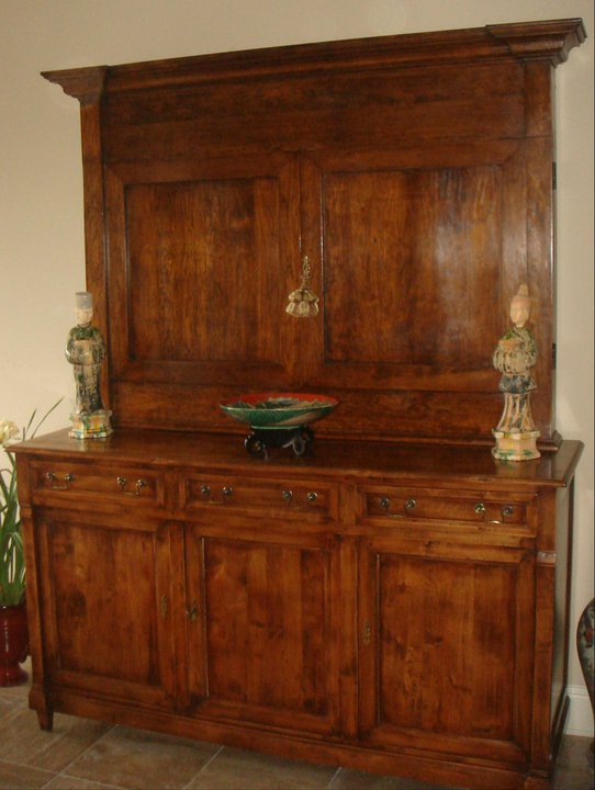 Custom-built cabinet in cherry to hide flat-screen TV with hand-wax finish to match bottom cabinet.